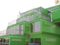 绿色的集装箱式建筑-盱眙生态园集装箱展厅 ()